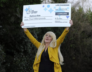 Melissa with big check above her head