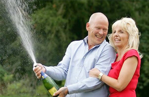 Angela and Dave Dawes - UK euromillions winners celebrating